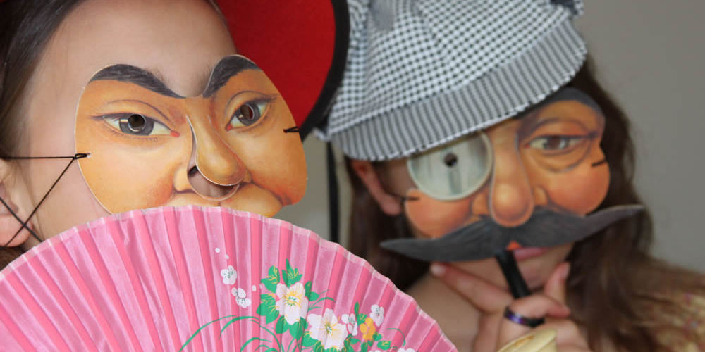 Teenagers in masks at Footlights Theatre Workshop