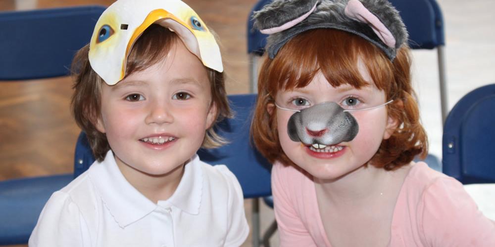 Young children in masks at Footlights Theatre Workshop